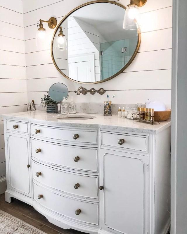 repurposed dresser used as a bathroom vanity photo by Instagram user @hkwdesign