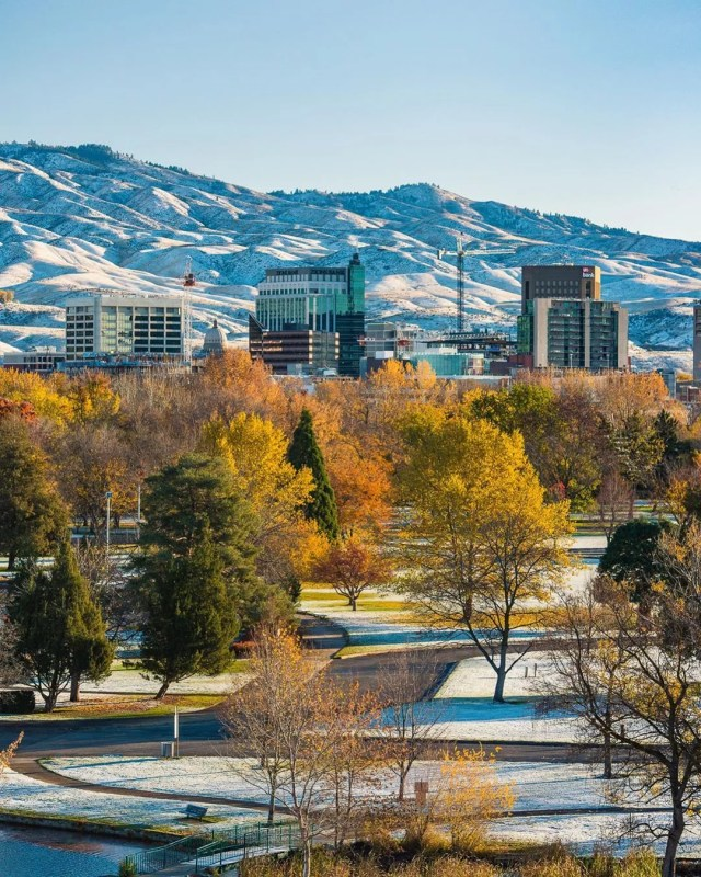 skyline of downtown Boise with the hills in the background with snow on the ground photo by Instagram user @chadcasephotovideo