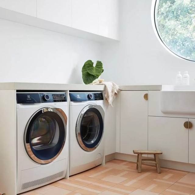 white laundry room with smart washer and dryer photo by Instagram user @designerappliancesau