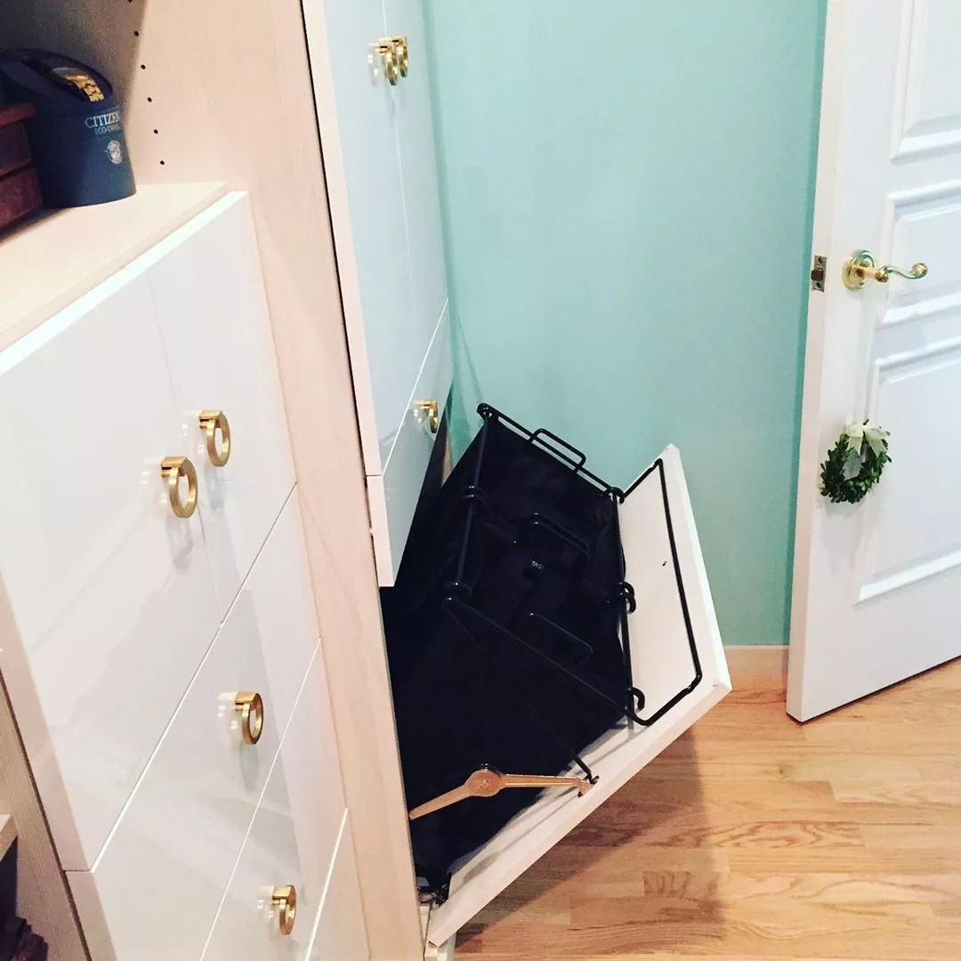 Tilt Out Laundry Hamper in Closet. Photo by Instagram user @designyourhappyspace