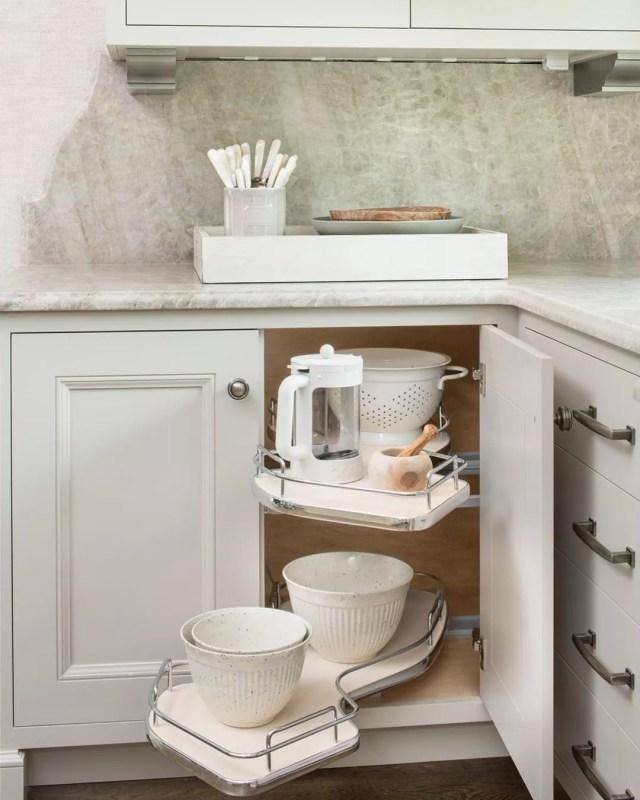 Hidden blind corner shelf in kitchen. Photo by Instagram user @revashelf