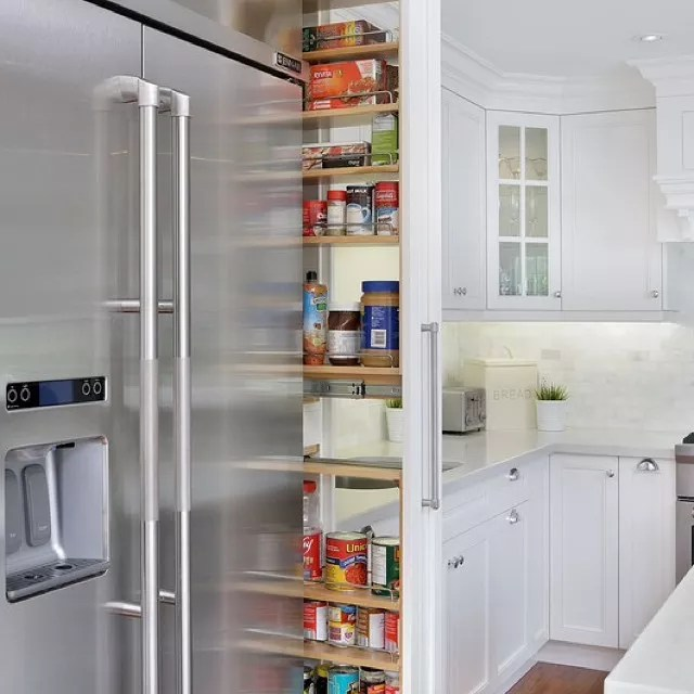 Hidden pull out pantry next to the fridge. Photo by Instagram user @accountablepropertymanagement