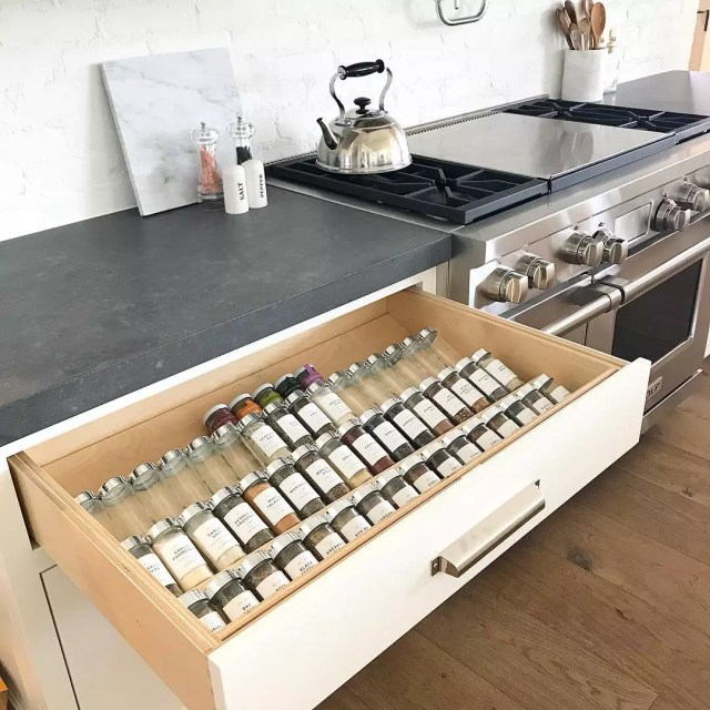 Spice rack installed in a spice drawer. Photo by Instagram user @chelseagthomas