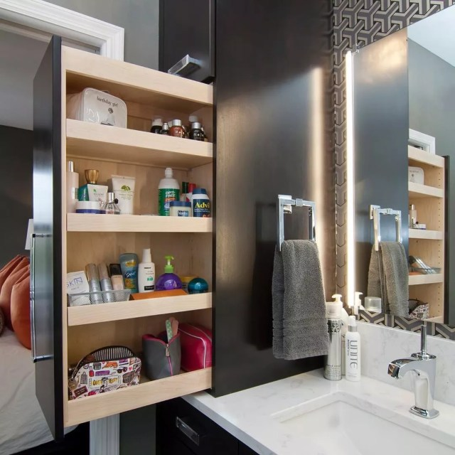 Pull Out Cabinet in a Renovated Bathroom. Photo by Instagram user @collegecitydesignbuild