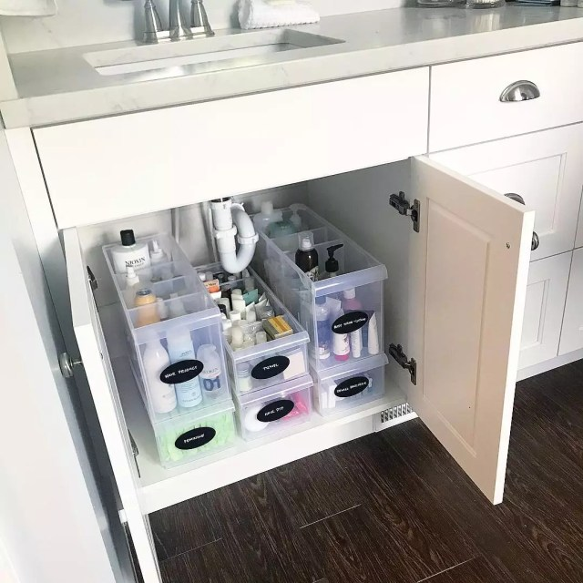 Plastic totes used for under sink storage organization in bathroom. Photo by Instagram user @chelseagthomas