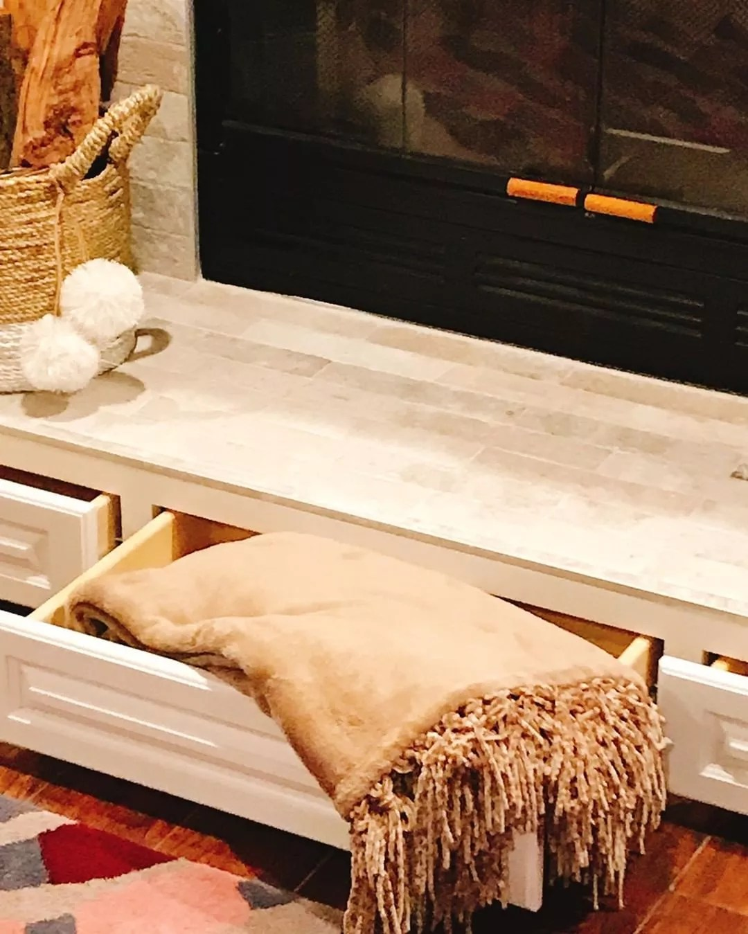 Fireplace Mantle with Built in Drawers Beneath Fireplace. Photo by Instagram user @lovedecor.homestaging