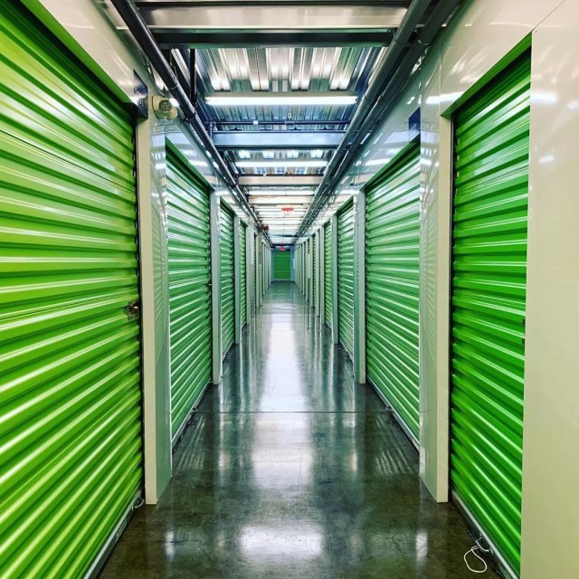 Green Storage Unit Doors in an Extra Space Storage Facility. Photo by Instagram user @tentpitcher