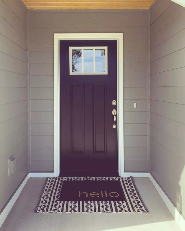 "Black Front Door with ""Hello"" Welcome Mat. Photo by Instagram user @youngmamajohnson"