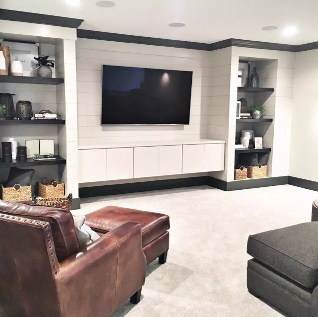 Finished Basement with Built in Shelving and Shiplap on Walls. Photo by Instagram user @mbkdesign_indy