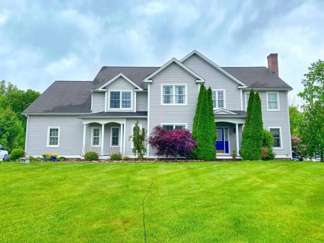 Large Home with Freshly Cut Green Grass. Photo by Instagram user @rppct