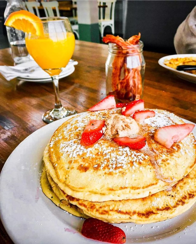 Stack of Pancakes with Strawberries on Top. Photo by Instagram User @ironroosterallday