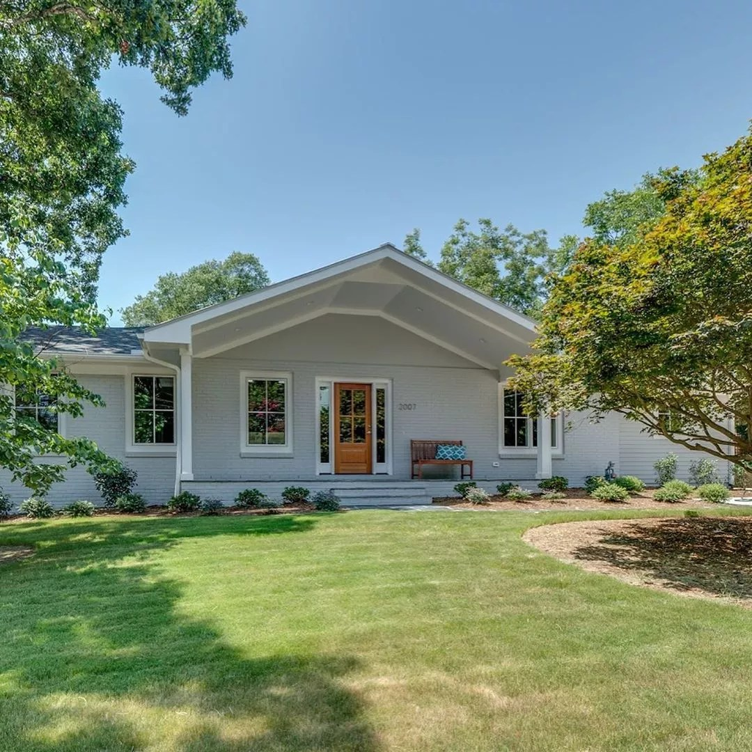 Gray Ranch Style Home with Large Front Patio in West Raleigh. Photo by Instagram user @chappellres