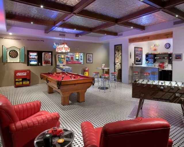 Basement Game Room with Pool Table, Foosball, and a Bar. Photo by Instagram user @sandverealty