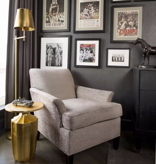 Comfy Arm Chair in Minimalistic Room with Sports Photos in Frames. Photo by Instagram user @anthonymichaelinteriors