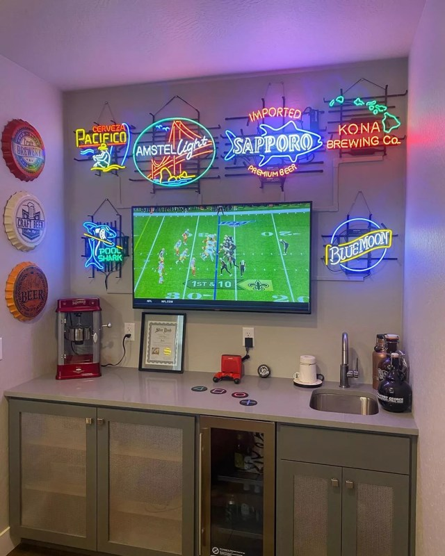 Basement Bar Area with TV and Neon Signs on the Wall. Photo by Instagram user @the.carto.grapher