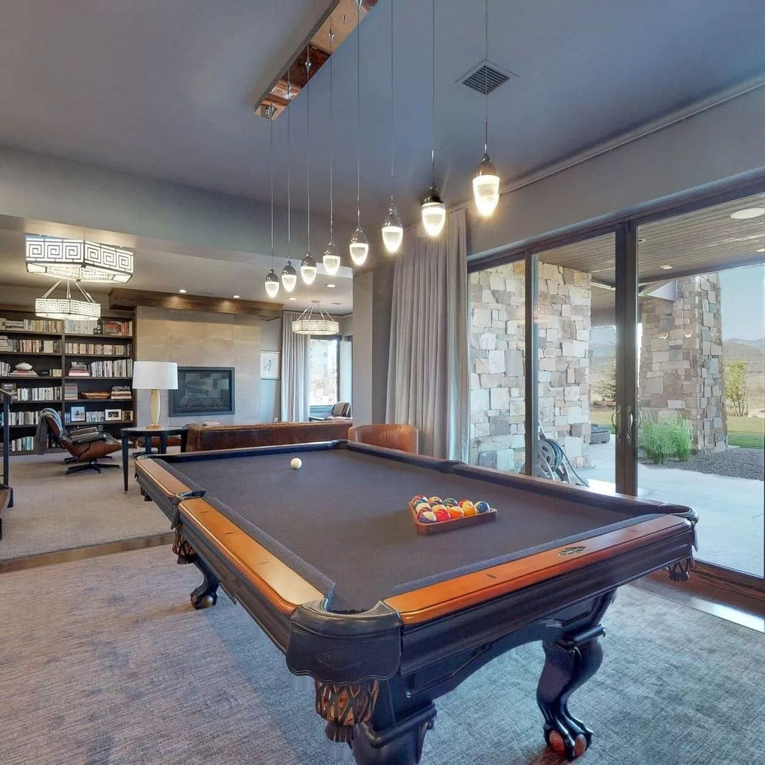 Basement Hangout Space with Pool Table and Nice Lighting Above. Photo by Instagram user @highlandcustomhomes