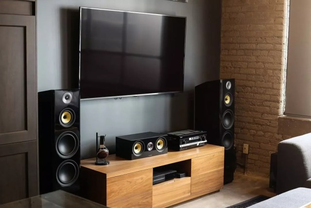 Classic Home Surround Sound Set Up Next to Large TV Hanging on the Wall. Photo by Instagram user @fluanceaudio