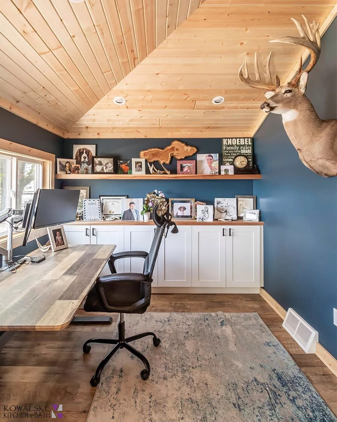 Classic Home Office with Large Reclaimed Wood Desk and Deer Head on the Wall. Photo by Instagram user @kowalskekitchenandbath