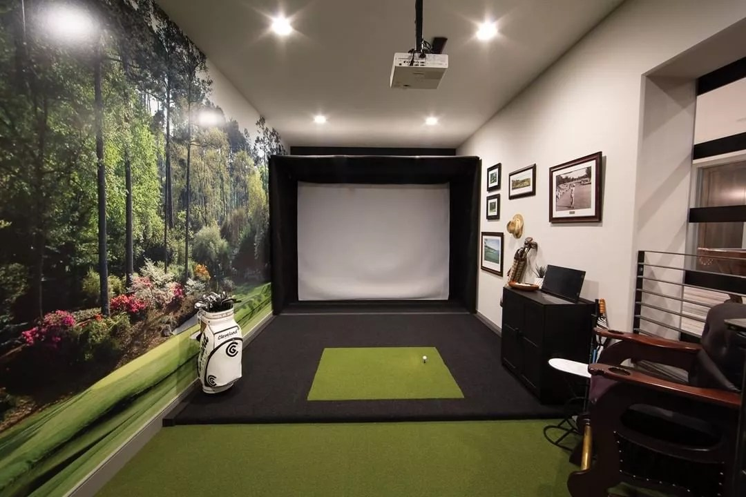 Basement Golf Simulator with Screen on the Wall and Mounted Projector. Photo by Instagram user @rainorshinegolf