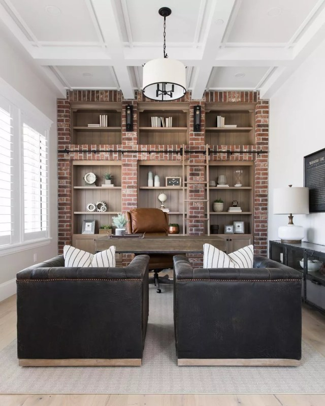 Rustic Looking Home office with Brick Wall and Leather Chairs. Photo by Instagram user @elementsstyle