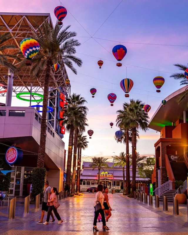 People Walking Around at Tempe Marketplace Under Fake Hot Air Balloons. Photo by Instagram user @tempemarketplace