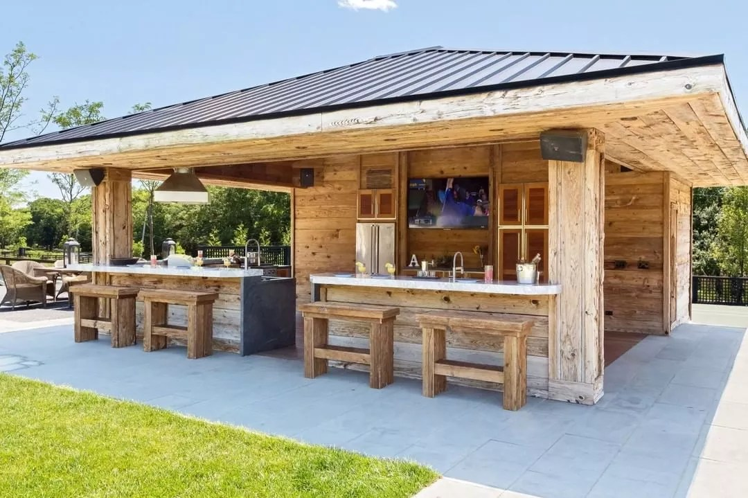 Huge Wooden Outdoor Living Space Structure Setup with Kitchen and Counter Space. Photo by Instagram user @premiercboutdoor