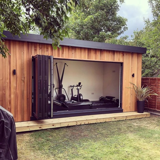 Backyard Home Gym in a She Shed with Sliding Glass Doors. Photo by Instagram user @smartmodular