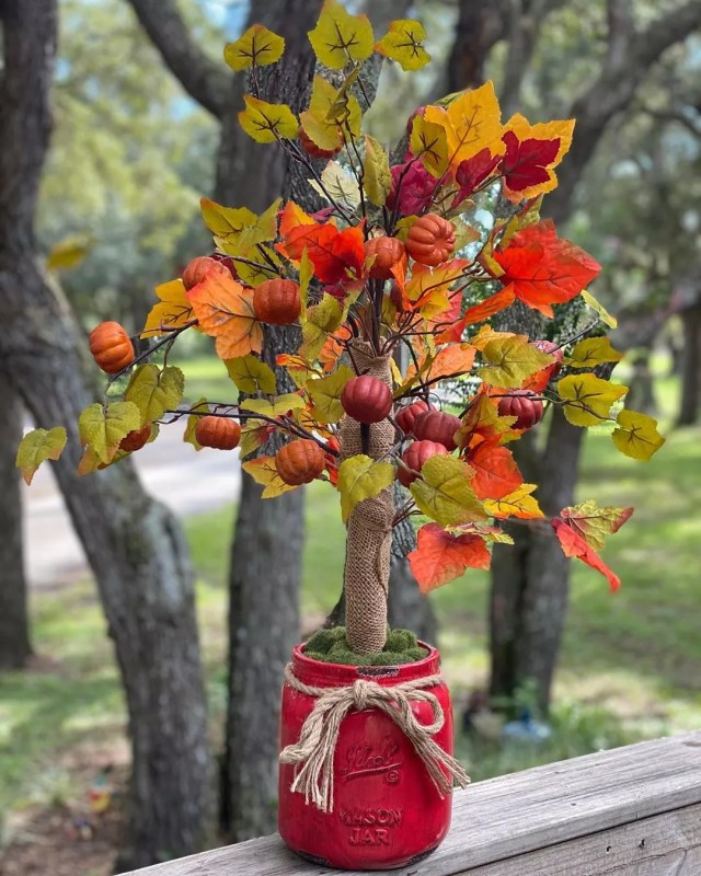 Mini Fall Tree with Pumpkins and Leaves on it. Photo by Instagram user @dreamoakdecor