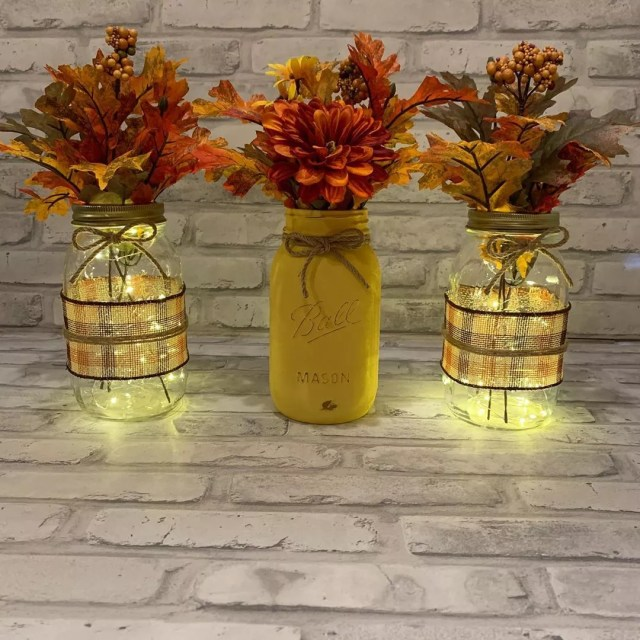 Mason Jars with Small LED Lights with Leaves in Them. Photo by Instagram user @home_decor_arrangements_by_ily