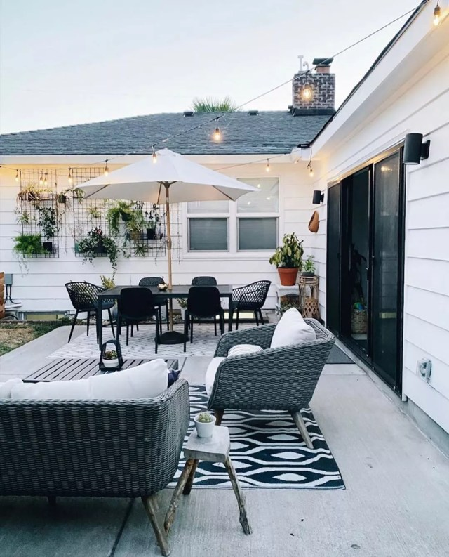 Backyard Patio with String Lights Overhead. Photo by Instagram user @arborand.co