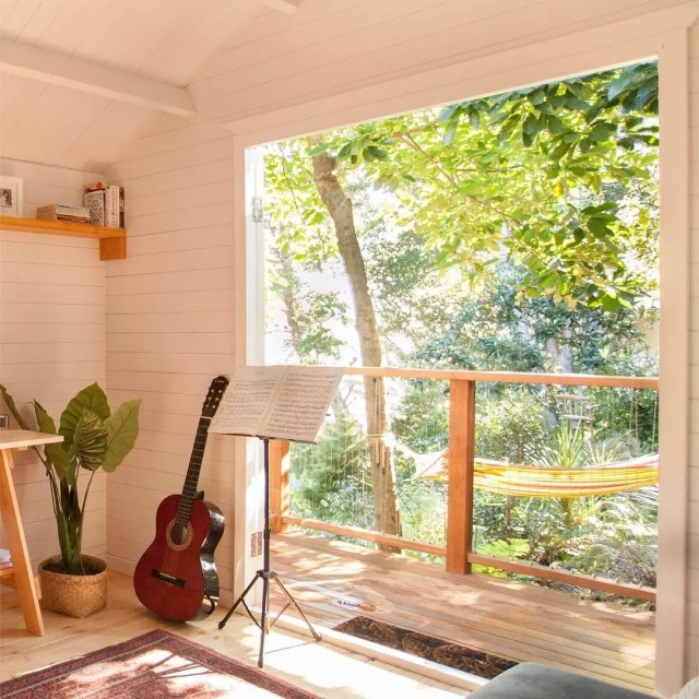 Backyard She Shed with Open Doors and Musical Instruments. Photo by Instagram user @homelandz_decor