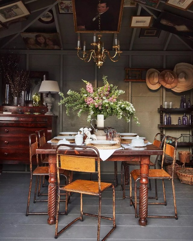 She Shed Dining Space Set Up with Antique Dining Room Table and Chairs. Photo by Instagram user @georgantas.design