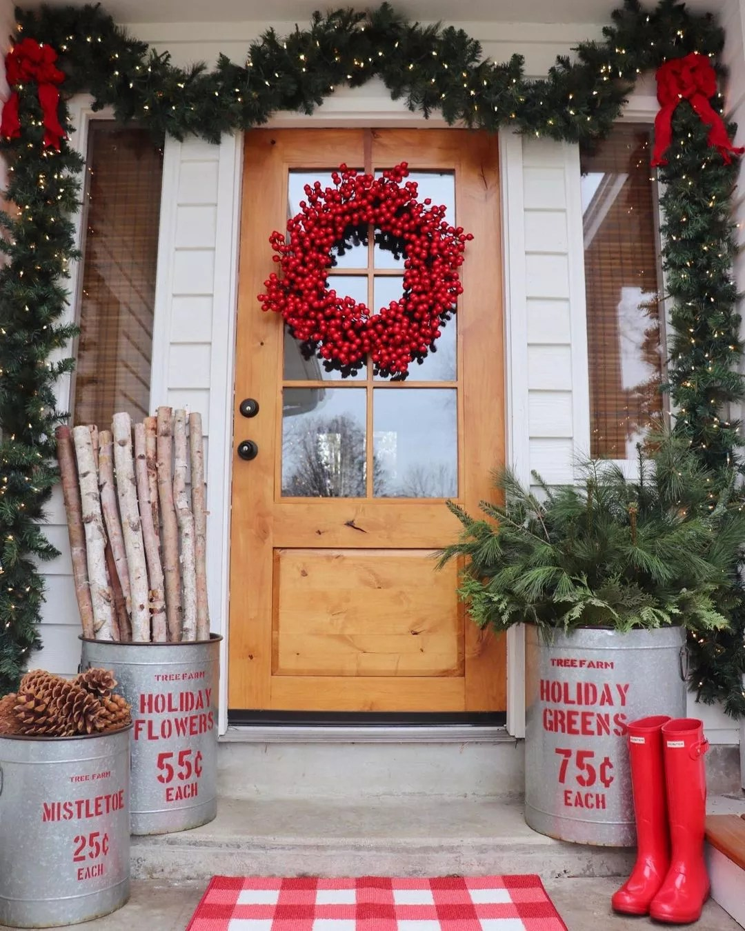 Large wreath made of cranberries hanging on a front door. Photo by @randilynnblog.