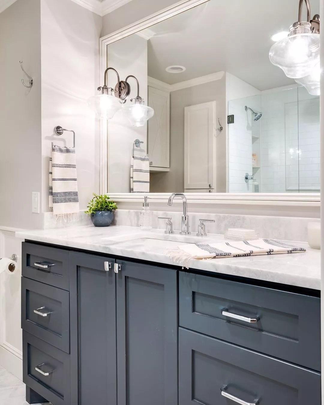 Bathroom with energy-efficient light fixtures. Photo by Instagram user @designdirectionsokc