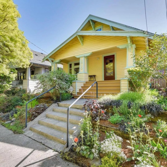 Older Craftsman Style Home Painted Yellow in Richmond, Portland. Photo by Instagram user @dcgpdx
