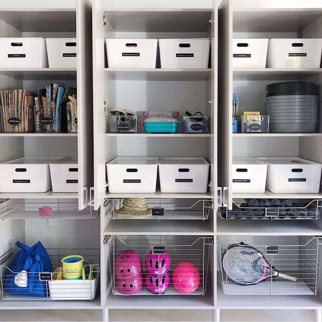 Garage Storage Space with Storage Bins on Shelves. Photo by Instagram user @orderly_inspiration