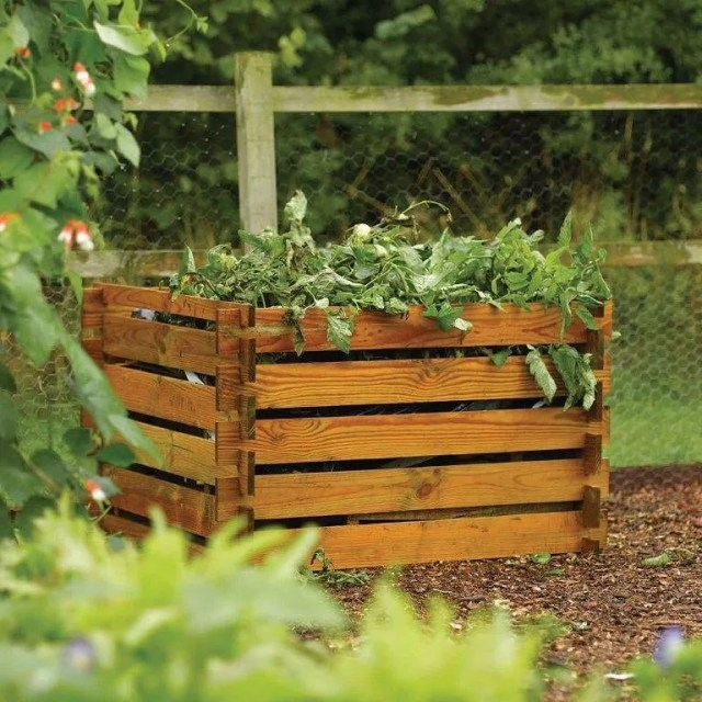 Homemade Composting Bin in a Backyard. Photo by Instagram user @harrodhorticultural