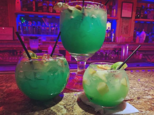 Three glasses of differing sizes of a green cocktail at Infinity Lounge NJ. Photo by Instagram user @infinityloungenj