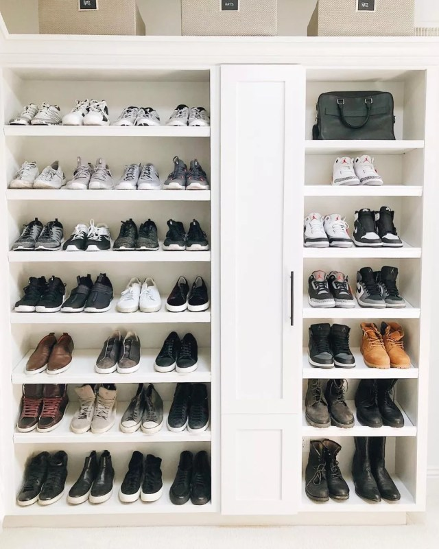 Shoes stored on open shelves in a closet. Photo by Instagram User @sdneat