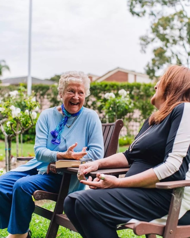 Older Woman Laughing with Younger Woman in Garden. Photo by Instagram user @retireyourway