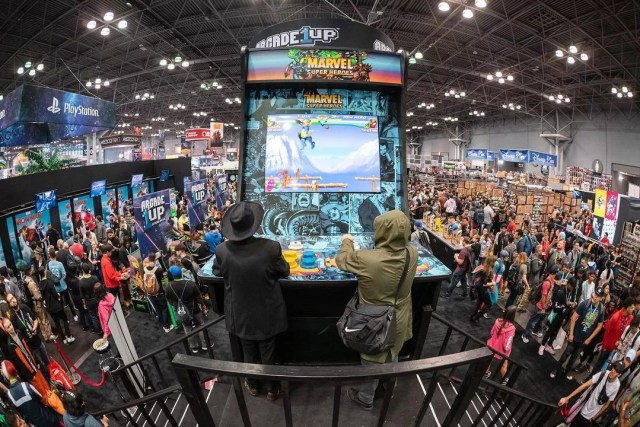 People Playing an Enormous Arcade Game at NYCC. Photo by Instagram user @newyorkcomiccon