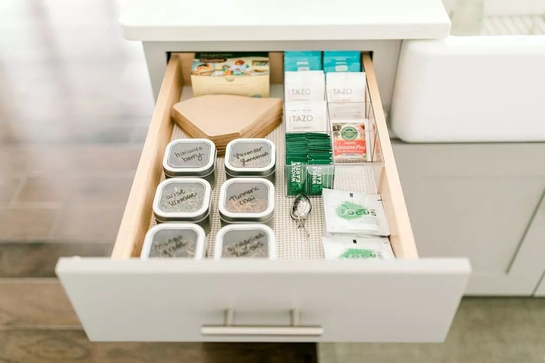 Open drawer with different teabags, and loose-leaf tea in an organized order. Photo by Instagram user @laurendamarie.