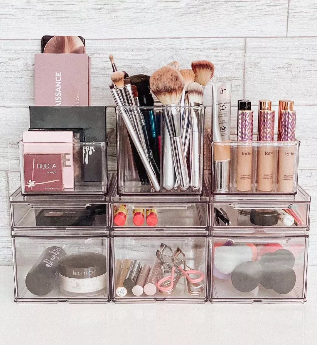 Makeup and makeup tools separated neatly in clear compartments. Photo by Instagram user @neatlyembellished.
