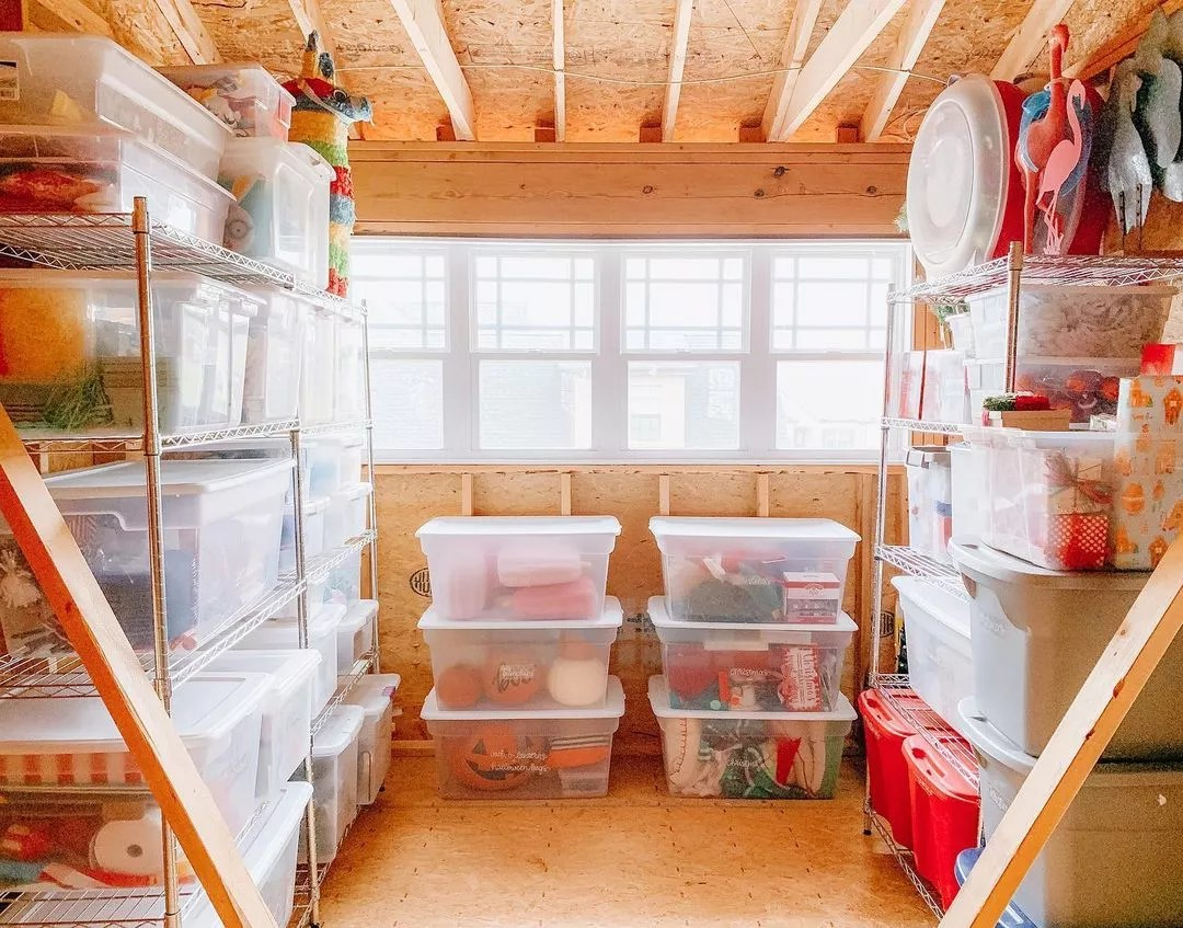 Storage room in a house house organized with clear plastic bins. Photo by Instagram user @thetidyhomenashville