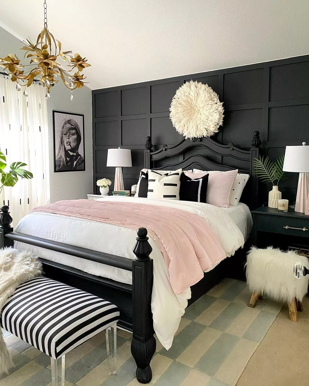 Trendy bedroom with a jet black accent wall. Photo by Instagram user @homeandfabulous.