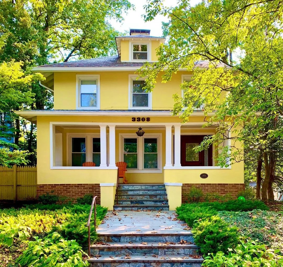 Multistory yellow East Coast craftsman style home in DC's Chevy Chase neighborhood. Photo by Instagram user @artyomshmatko