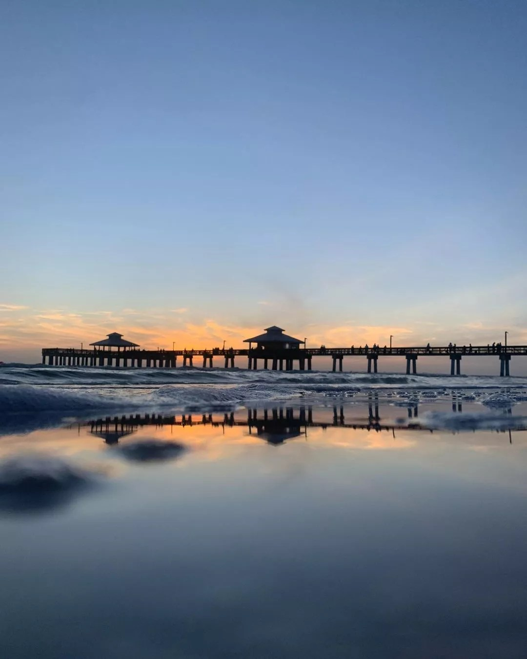 Sunset Photo of the Pier at Fort Myers Beach. Photo by Instagram user @ocana.photography