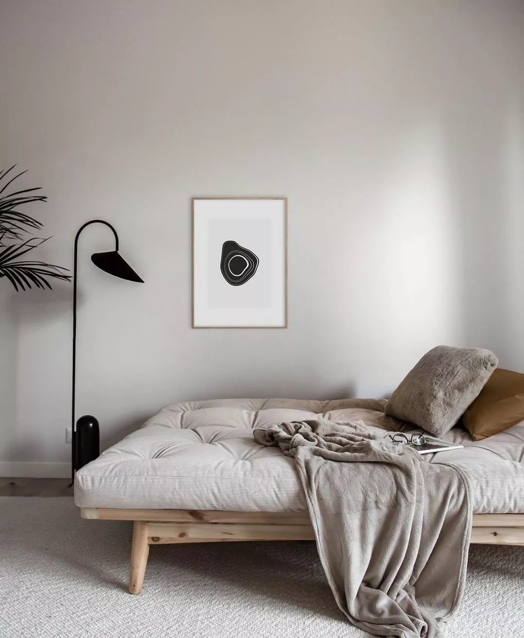 Scandi style day bed with light color palette. Photo by Instagram user @visualpleasuremag