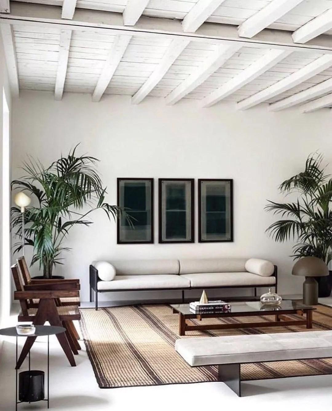 Japandi designed living room with white walls and dark wood furniture. Photo by Instagram user @srelle_studio