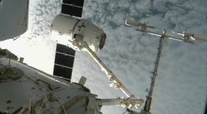 ISS grabs SpaceX Dragon capsule with Canadarm, during the docking sequence